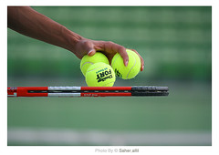 PLAY TENNIS ,, (Nasser Bouhadoud) Tags: man sport yellow canon ball eos 350d model play hand stadium location tennis international khalifa 200 mm khalid racket nasser doha qatar saher 3good allil saherallil ef70 f4lusm