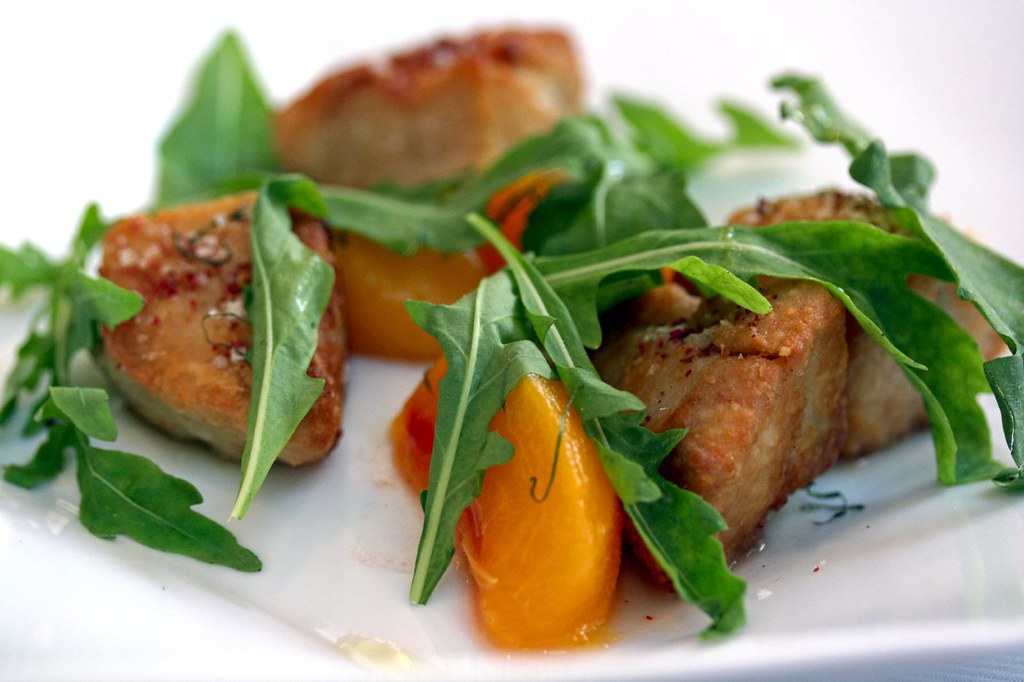 Macro of Crispy Sweetbreads and Fragrant Pickled Peach, Wild Arugula, and Pink Peppercorn