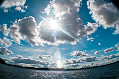 back from sailing (frischmilch) Tags: sky sun lake water clouds boat sailing poland fisheye sail rhyn sailingmasuria