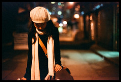 (Lefty Jor) Tags: street leica light hk film girl hat night scarf hongkong 50mm dof bokeh voigtlander f11 m6 nokton misu solaris400 voigtlandernokton50mmf11