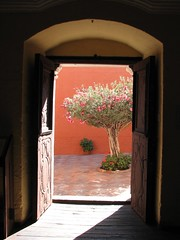 Door to heaven (Melville B.) Tags: light tree peru doorway convent arequipa prou santacatalina santacatalinamonastery 10faves powershots3is s3is 25faves defidefiouiner superaplus aplusphoto overtheexcellence melvilleb