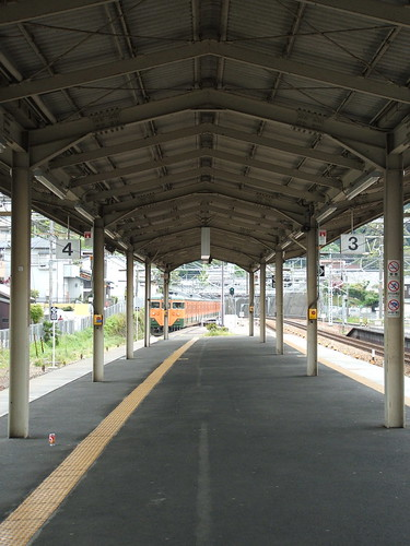 train pulling off at a shiga station