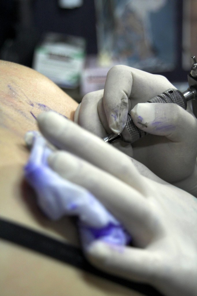 getting ink done (Colour) · Tribal Sun Tattoo