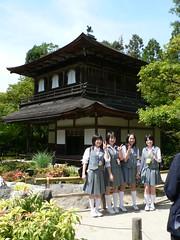 schoolchildren posing for a photo in front of Ginkaku-ji