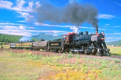 Grand Canyon Railway steam locomotive #18 (ex-Lake Superior and Ishpeming, since sold to a tourist railway in Colorado) and train leaving Williams, AZ, summer of 1999. (Ivan S. Abrams) Tags: california arizona france newmexico santafe minnesota daylight blw colorado lima pennsylvania grandcanyon ivan maryland trains bulgaria sp westvirginia flagstaff getty shay mikado clovis abrams kazakhstan railways tehachapi belen locomotives cajon gettyimages astana abo sncf southernpacific willmar smrgsbord alco tucsonarizona espee 282 atsf 141r warbonnet steamlocomotives riordan 12608 bdz cassscenicrailway onlythebestare ivansabrams trainplanepro pimacountyarizona safyan arizonabar turksib arizonaphotographers ivanabrams cochisecountyarizona tucson3985 gettyimagesandtheflickrcollection copyrightivansabramsallrightsreservedunauthorizeduseofthisimageisprohibited tucson3985gmailcom ivansafyanabrams arizonalawyers statebarofarizona californialawyers copyrightivansafyanabrams2009allrightsreservedunauthorizeduseprohibitedbylawpropertyofivansafyanabrams unauthorizeduseconstitutestheft thisphotographwasmadebyivansafyanabramswhoretainsallrightstheretoc2009ivansafyanabrams abramsandmcdanielinternationallawandeconomicdiplomacy ivansabramsarizonaattorney ivansabramsbauniversityofpittsburghjduniversityofpittsburghllmuniversityofarizonainternationallawyer