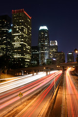 Above Freeway 110 (A Sutanto) Tags: california road ca city urban usa building cars skyline night america lights evening la losangeles twilight highway downtown traffic dusk 110 overpass freeway lighttrails streaks abigfave superaplus aplusphoto