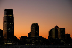Jersey City waterfront (Dreamer7112) Tags: nyc newyorkcity sunset ny newyork 20d silhouette skyline architecture backlight skyscraper contraluz lights evening newjersey twilight jerseycity skyscrapers dusk manhattan canon20d nj silhouettes canoneos20d illuminated batterypark backlit silueta siluetas exchangeplace lowermanhattan nightfall i♥ny eos20d eveninglight cesarpelli novaiorque jerseycityskyline pelli goldmansachstower 30hudsonstreet jerseycitywaterfront frombatterypark news21 sachstower