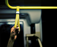 Tram 96 to East Brunswick, 6.51 pm. (jonaspeterson) Tags: yellow delete2 1 hand save3 tram australia melbourne save7 save8 delete save brunswick save2 dailycommute explore save9 save4 strap goinghome 5d save5 save10 save6 publictransport topf150 savedbythedeltemeuncensoredgroup commuters canonef50mmf14usm pixelboy save11 explore1 wwwjonaspetersoncom