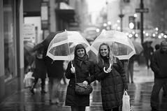 Bubble dome umbrellas (yeryi) Tags: street city nyc newyorkcity girls 2 two portrait blackandwhite bw usa ny newyork blancoynegro rain america skyscraper umbrella blackwhite calle lluvia nikon noir dof skyscrapers unitedstates bokeh retrato manhattan 14 85mm ciudad clear dos dome chicas nikkor umbrellas 85 paraguas blanc negre estadosunidos nuevayork rascacielos d90 85mm14 nyer nikkor85mm14 nikon85mm14 brollybubble
