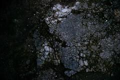 Fractured (skinr) Tags: texture mexico raw ruin bestviewedlarge ground mayan cozumel cracks fracture sangervasio adobelightroom skinr canon400d canondigitalrebelxti adobephotoshoplightroom wwwjskinnerphotocom