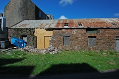 Stone, corrugated iron and plywood