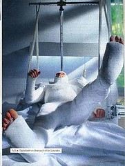 Ad with a man in a full body cast (Ivana Cast) Tags: man feet hospital toes fingers ad traction advertisement patient immobilized legcast plastercast hospitalbed medicalequipment bodycast fullbodycast whitecast armcasts