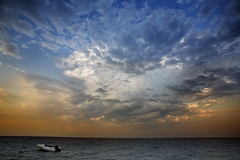 Still water, dreamy sky (Gilad Benari) Tags: ocean sunset sea sky water clouds turkey boat ship different orangecounty motorboat anatalya