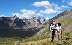 hikers in valley below the Tombstone Mountains