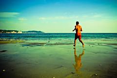 Beach jogger (manganite) Tags: blue sea summer sky people hot reflection men green beach nature topf25 water colors sport yellow japan strand digital geotagged asian japanese interestingness xpro nikon colorful asia seasons tl candid kamakura young playa guys explore  nippon d200 interestingness106 nikkor dslr kanagawa nihon kanto yuigahama i500 18200mmf3556 utatafeature manganite nikonstunninggallery ipernity anawesomeshot geo:lat=35309798 geo:lon=139539038 date:year=2006 date:month=september date:day=2 format:ratio=32