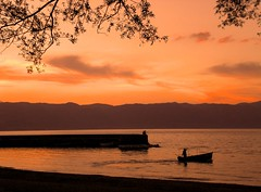 Mood at the lake (horstgeorg) Tags: sunset orange lake art water colors silhouette reflections boat fishing fisherman searchthebest macedonia ohrid mazedonien mazedonia ohridlake diamondclassphotographer