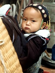SaPa market. Black Hmong baby. (Linda De Volder (the new layout is horrible)) Tags: travel portrait people mountain barn children geotagged kid asia southeastasia child market culture tribal vietnam kind criana tribe ethnic minority enfant nio soe sapa tribo stam indochine hilltribe indochina dziecko tribu bambino stamm   ethnicminority  lapsi  copil dijete trib  montagnard dt trib  heimo minoritethnique  passionphotography stamme  impressedbeauty flickrdiamond pokolenia laocaiprovince ethnischeminderheid   lindadevolder  plemena pokolen