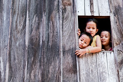 Wallflowers #3 (Wen Nag (aliasgrace)) Tags: wood family boy people home window girl face topv111 wall kids children asian kid asia cambodia southeastasia asians child faces explorer siblings explore 2550fav top20flickrkids 1in10f50v kampongcham aliasgrace angkorphotographyfestivalcontest superbmasterpiece hanchey
