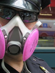 NYPD Cop Wearing Respirator during Steam Explosion (buff_wannabe) Tags: nyc cops pipe explosion police nypd steam unusual incident asbestos