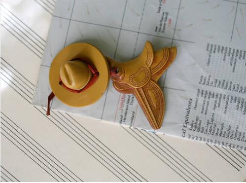 Celluloid Cowboy Hat + Carved Saddle