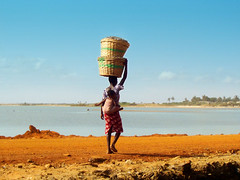 mother ghana (^ mAyAkA ^) Tags: africa blue red sea portrait orange woman fish motion beach work catchycolors walking movement child basket mother ghana westafrica motherhood coolest motherandchild carrying prampram interestingness114 burdens i500 firsttheearth diamondclassphotographer flickrdiamond chercherlafemme