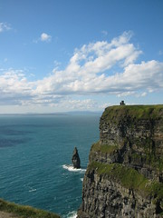 At the Cliffs of Moher (bettlebrox) Tags: ocean blue ireland sea cliff tower castle water oneaday clouds island clare eire cliffs atlantic craggy mick thesea moher 2007 craggyisland irelandmyireland mickt