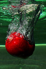 The splash of an apple (LalliSig) Tags: red food macro reflection green texture apple water glass studio iceland blurry highcontrast splash