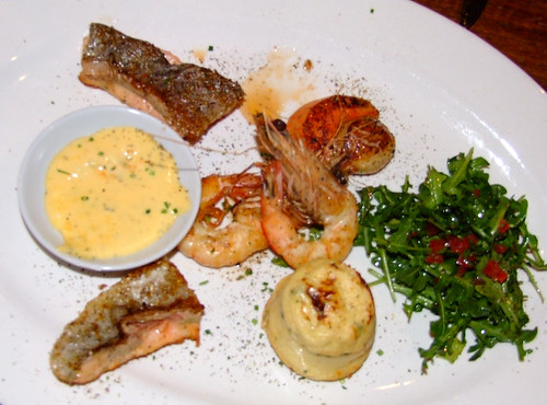 Hot Seafood Plate featuring scallops, prawn, fish and a rocket and tomato salad served with bernaise sauce