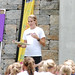 Soccer player Heather Mitts addresses the audience at a Girl Talk event in Cincinnati, OH