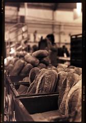 Loaves (heritagefutures) Tags: bread fuji markets stall australia rangefinder kingston epson canberra fujica act perfection loaves fujicolor nps160 caffenol silverfast g690bl caffenolc negafix