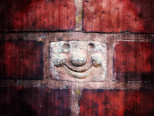 Quotes About Happiness And Smiling. This smiling brick came