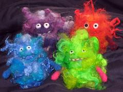 fuzzeh quad (moxie lieberman) Tags: wool goofy whimsy locks fiber roving bff fingerpuppet needlefelted dryfelting dryfelted madebymoxie fuzzeh