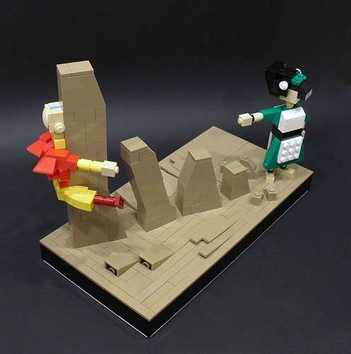 A picture of a Lego sculpture featuring a Toph-like character raising up brown stones. An Aang figure crashes into one of the earth structures.