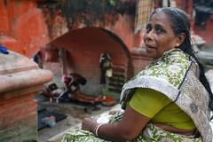 Massage | Kolkata (Rohit Markande) Tags: old woman india man river massage ritual dip kolkata ghats hooghly