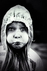 (L caitlin) Tags: bw cute girl face mouth eyes funny child cheeks raincoat