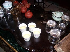 Tea cups and tiny tea pots at a tasting in Chinatown Los Angeles