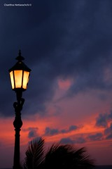 A Garden Lamp and the colours of the sky (charithra Hettiarachchi) Tags: ocean sunset red sea sky sun beach lamp waves colours srilanka mtlaviniahotel top20srilanka
