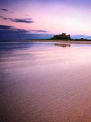 Dusk at Bamburgh (aygee1) Tags: pink sunset seascape castle beach landscape dusk northumberland bamburgh