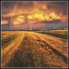 Golden Evening (adrians_art) Tags: light red sky orange weather yellow clouds dark geotagged evening landscapes bravo shadows silhouettes best rainbows marshes geotags flickrs supershot abigfave superaplus aplusphoto wowiekazowie superhearts