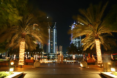 Dancing Palms (seven years) Tags: tree fountain skyline night marina canon dubai skyscrapers palm 400d