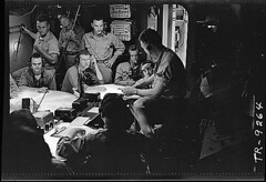 Lt. Cdr. A.F. Fleming, fighter director, in plot room of USS Lexington (CV-16) during a strike in the Gilbert & Marshall Islands., 11/1943 (The U.S. National Archives) Tags: bw ship usslexington aviation wwii sailors worldwarii pto aircraftcarrier usnavy usn warship steichen secondworldwar worldwartwo fleming navalaviation unitedstatesnavy pacifictheatre pacifictheater edwardsteichen essexclass usslexingtoncv16 cv16 cvt16 pacifictheaterofoperations usnationalarchives pacifictheatreofoperations edwardjsteichen avt16 cva16 nara:arcid=520799 usslexingtoncva16 usslexingtoncvs16 cvs16 usslexingtoncvt16 usslexingtonavt16 affleming fighterdirector