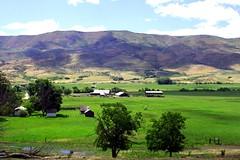 Hill Country Farm Ola Idaho (Gerry Slabaugh) Tags: ranch flowers mountains church nature barn landscape farm scenic hills idaho valley slabaugh gerryslabaughphoto gerryslabaughphotography