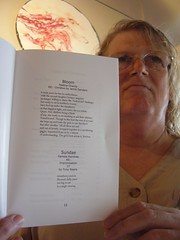 "Pamela Raintree holds the chapbook ""Standing at the Edge"""