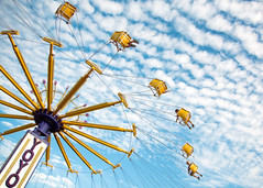 Swings on High (Todd Klassy) Tags: above carnival summer sky people motion color public festival metal horizontal wisconsin clouds fun outdoors lights fairgrounds flying moving high ride arms action circus statefair swings machine bluesky fair chain celebration event entertainment riding photograph seats fete carnivale physics amusementpark rotation swinging midway countyfair 4h dramaticsky rotating wi yoyo mechanism trapeze streetfair fayre carny intheair elkhorn agriculturalfair tilting carnivalride vividcolors carnie stockphotography travelingcarnival colorimage chairoplane ruralscene centripetalforce walworthcountyfair wisconsinphotographer summerinwisconsin throughtheair elkhornwisconsin toddklassy mechanicalstructure chanceridesmanufacturing