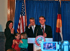 Michael Bennet with family and, behind him, Governor Ritter. (Image used under CC license from Jeffrey Beall)