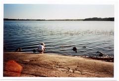 Untitled (Janne Koivisto) Tags: sea film water girl rock 35mm finland helsinki olympus xa olympusxa scannedimage