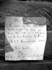 Note to a Dead Friend (toddwshaffer) Tags: nyc newyorkcity 2002 bw white eastvillage newyork black france brick paper dead death friend village rip joe ps buddy clash holly east note tape your hero record letter pal tomorrow strummer avenuea buddyholly 7thstreet joestrummer thompkinssquarepark december222002 toddshaffer