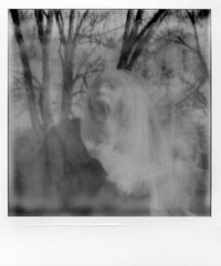 Trapped (Emily Savill) Tags: auto b portrait blackandwhite bw white selfportrait black film face analog self project polaroid weird trapped scary focus mesh jaw uv w creepy 600 terror analogue af timer pinstripe impossible impulse horrific px px600