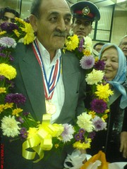 David Bahman (FarshadPix) Tags: portrait flower london smile mobile happy gold persian airport iran country honor medal iranian patriot tehran mehrabad         labkhand        foroodgah