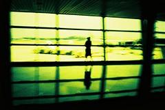 uncertainty (Jayna) Tags: shadow film airport xpro crossprocessed fuji slide olympus velvia xa 50 interestingness155 i500